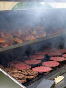 outdoor bbq catering grill showing burgers chicken photo.